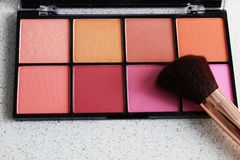 Close up powder makeup blush palate on marble texture background. Close up powder make-up blush palate on marble texture background stock photos