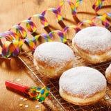 Close up Powdered Sugar Raised Donuts on Screen Stock Photo