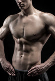 Close-up of a power fitness man on black background Royalty Free Stock Image
