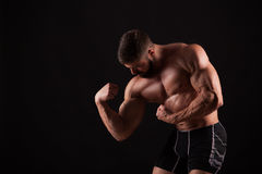 Close-up of a power fitness man`s hand. Strong handsome young bodybuilder demonstrate his muscles and biceps Royalty Free Stock Image