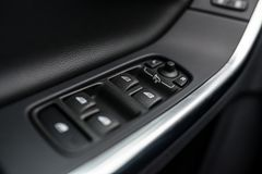 Close-up on power windows and mirrors control buttons Royalty Free Stock Photography