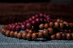 Close up prayer beads  on prayer rug stock photography