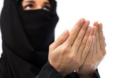 Close up of praying muslim woman in hijab Stock Photography