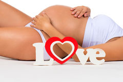 Close-up pregnant belly. Concept of pregnancy and mother love. Royalty Free Stock Photos