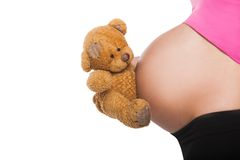 Close up of pregnant belly with toy. Woman Royalty Free Stock Photography