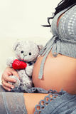 Close up of pregnant belly. Royalty Free Stock Images