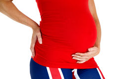Close-up of a pregnant mother wearing a red top Royalty Free Stock Photography