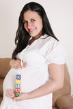 Close up of a pregnant woman with baby letters on her hand Royalty Free Stock Images