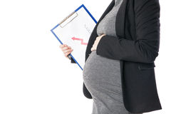 Close-up of pregnant woman holding folder with business graph Royalty Free Stock Photography