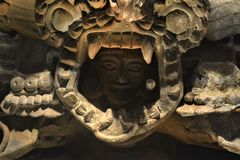 A prehispanic god watching from his ritual mask. A close up of a prehispanic god watching from his ritual mask beutiful combination of color and light, the royalty free stock images