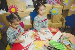 Close up preschool kids drawing Stock Photos