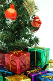 Close up of presents under christmas tree. Over white Stock Photo