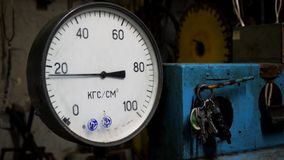 Close up for pressure gauge, measuring instrument at a factory. Manometer with wavering arrow and a bunch of keys stock photo