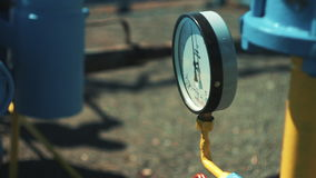 Close-up pressure gauge with shut-off valve. Gas storage and supply station. Pipelines for gas transportation. Oil and. Gas industry. Money business stock video