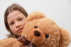 Close-up of the preteen girl with her teddy bear Royalty Free Stock Photography