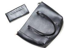 Close-up preto elegante do saco e da bolsa, vista superior, isolada no fundo branco imagens de stock royalty free