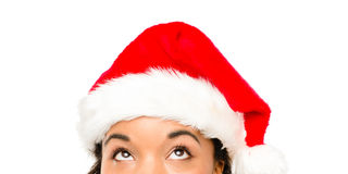 Close up of pretty African American girl wearing Christmas hat. Looking up Royalty Free Stock Image