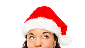 Close up of pretty African American girl wearing Christmas hat. Looking up Stock Image