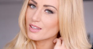 Close up Pretty Blond Woman Face with Gray Eyes stock video footage