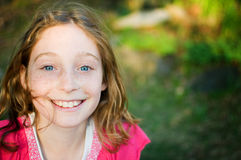 Close up of a pretty blue eyed girl. Beautiful blue eyed twelve year old girl looking at the camera and smiling Stock Photos