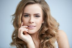 Close up Pretty Curly Young Woman Hand on Face Stock Photos