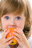 Close-up of pretty girl eating an apple, isolated. Over white Stock Photo