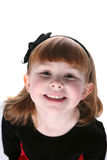 Close up of pretty little girl with black hair bow Stock Image