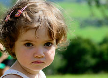 Close up of a pretty little girl in the garden Royalty Free Stock Photo
