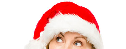 Close up of pretty mature woman wearing santa hat for christmas Royalty Free Stock Photo