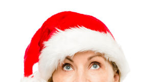 Close up of pretty mature woman wearing santa hat for christmas Stock Photography