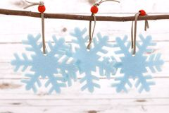 Festive Christmas decoration on a whitewashed wooden background stock image