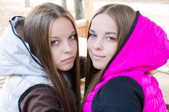 Close-up of pretty twins  Stock Images