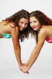 Close-up of pretty twins holding by the hands Royalty Free Stock Photo