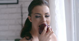 Close up Pretty Woman Biting Sweet Red Apple stock video footage