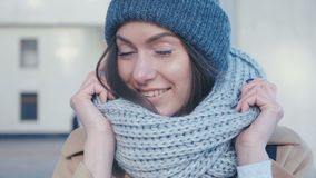 Close-up of a pretty young woman in a hat and scarf cute smiling stock footage