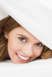 Close up of a pretty woman resting in bed Stock Photography