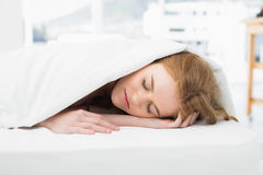 Close up of a pretty woman sleeping in bed Royalty Free Stock Image