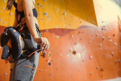 Close up of pretty woman standing in a climbing gym Stock Images