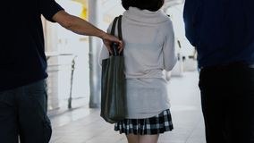 pickpocket thief took wallet of pretty girl while walking Royalty Free Stock Photos