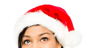 Close up of pretty woman wearing christmas hat looking up isolat Royalty Free Stock Images