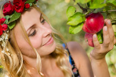 Close up on pretty young apple fairy with three Stock Image