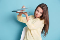 Close-up of a pretty young girl holding laptop computer Stock Photo
