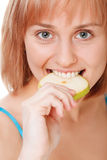 Close up pretty young woman holding an apple Royalty Free Stock Image