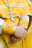 Close-up of priest's hands. In traditional clothes Royalty Free Stock Photography