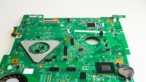 Close up of a printed green computer circuit board. Control board with electronic components and microcircuits stock photography