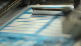 Close-up of printing flyers in print shop stock video footage