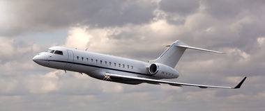 Close up of a private jet flying Royalty Free Stock Photography