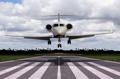 Close up of a private jet landing Stock Images