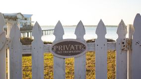 Close up - Private No Trespassing sign picket fence Royalty Free Stock Image