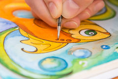 Close-up of process of drawing goldfish Stock Images